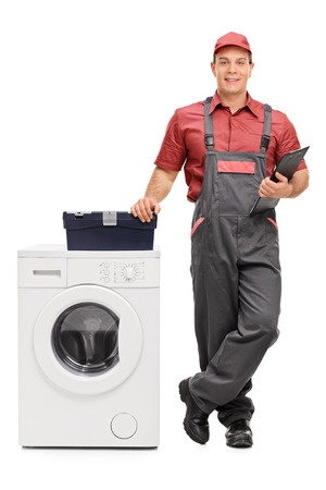 apliance repairman standing beside dryer